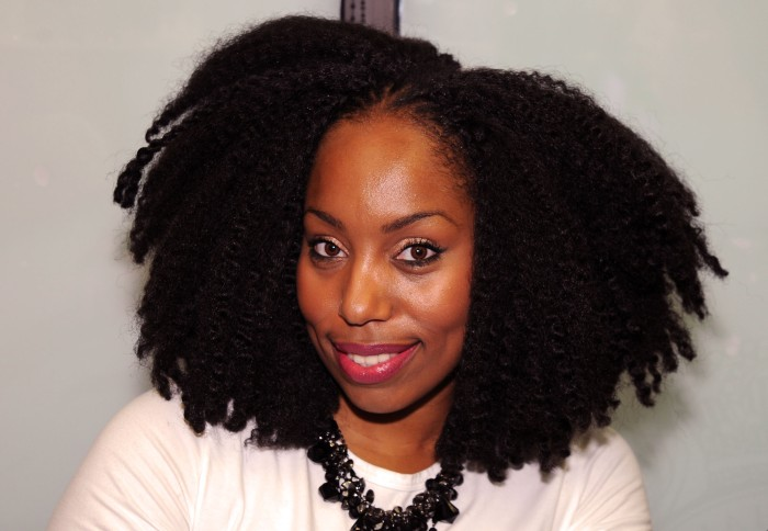 Cierra Thurman -Author wearing a natural hairstyle.