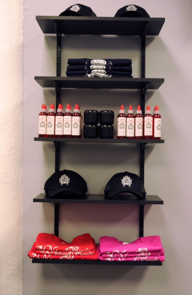 Product display on including t-shirts, caps and hair /scalp creams.
